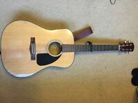 Fender acoustic guitar with leather strap and capo