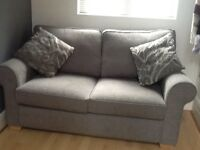 2 seater grey corded fabric sofa bed with pocket sprung mattress in first class condition