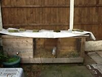 Large rabbit hutch with large enclosed metal run.
