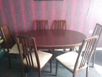 a dining table and 6 chairs