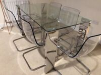 Hardly used chrome glass dining table with 6 transparent chairs.