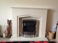 Marble fireplace with built in lights also remote control electric fire with various control options
