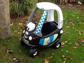 Little Tyke sit in police car