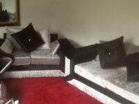 Two seater and three seater sofas crushed velvet grey and black new