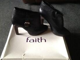 Black leather platform boots
