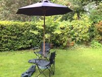 Large umbrella, stand and 3 chairs.