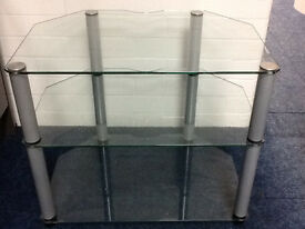 60CM CLEAR GLASS STAND WITH SILVER LEGS .