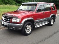 Isuzu Trooper Lwb DT (maroon grey metallic) 1999