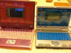 2 childrens play laptops