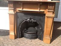 Solid Oak Fire Surround circa 1890 with iron reproduction fire.