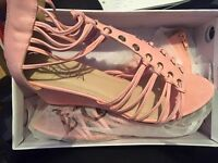 Brand new pink wedge sandals size 8