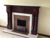 Mahogany surround, cream inset and base, 18inch opening. Good condition .