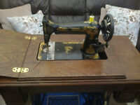 restored Singer treadle table in walnut just needs 4 small drawer knobs to finish