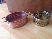 Two copper plant pots.