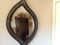 Vintage/retro oval mirror in gold/bronze/black beaten steel frame