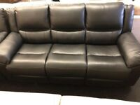 Black leather 3 + 2 seater sofas