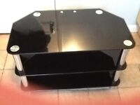 Universal Black Glass with Chrome legs T.V Stand.