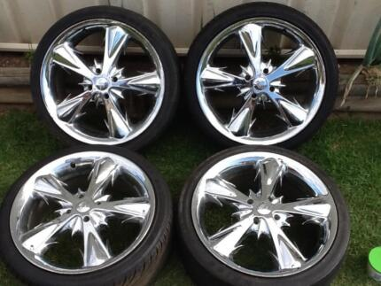 "Four 17"" X 7.5"" chrome wheels with 4 X 100 stud pattern. Tyres ar"