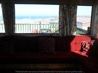 AMAZING SEA VIEWS AND LARGE ENCLOSED DECKING, TWO BEDROOM 6/7 BERTH CARAVAN