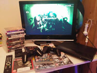 Playstation 3, 22 inches tv, 19 games, 2 controlers