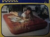 Double blow up bed with pump