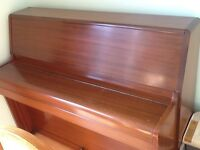Upright piano by Barrett & Robinson in very good condition