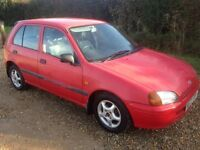 TOYOTA STARLET 1.3 SPORTIF 5 DOOR MANUAL PETROL HATCHBACK IN RED 1997/R WITH 82K AND 10 MONTHS MOT