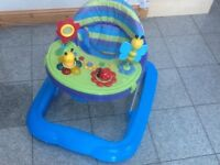 Baby walker with battery operated toy and musical console in full working order-batteries included