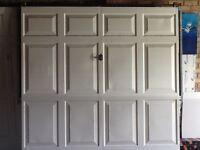 GARAGE DOORS TWO WHITE MATCHING METAL DOORS