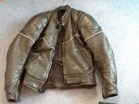 Leather jacket with armoured shoulders and elbows.