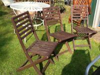 Three wooden garden chairs