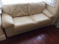 3 seater cream faux leather settee.