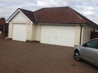 Garage roof, tiles and and roof trusses