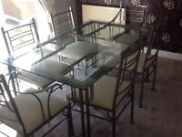Dining table 6 chairs, coffee table, 2 lamp tables, display rack, BARGAIN