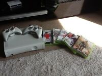 Xbox 360 perfect condition with 2controllers and games