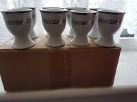 8 White china egg cups, brand new