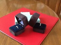 Platinum diamond engagement ring and wedding band byTiffany & Co