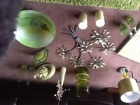 A selection of green ornaments, pictures, wall art etc