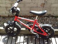 Child's small red bike