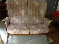 Two Seater Ercol Settee. In good condition but the straps need replacement.