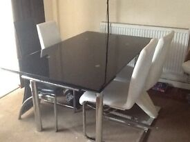 Good condition dining table and 4 chairs for sale