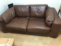 Brown leather two-seater sofa free to collector