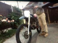 LARGE. WHEEL OFF ROAD. 4 STROKE. MOTORBIKE