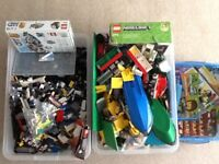 Two large boxes of Lego with guides