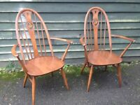 Pair of ERCOL Swan backed carver chairs