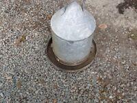 Vintage galvanised chicken feeder