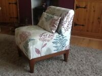 Small floral print occasional chair.