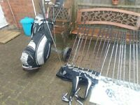2 sets of golf clubs a cart and a bag +extras