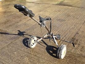 Used silver frame black clips and shekels golf trolley with some usage markings