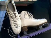 Size 5 Risport ice skates in worn, but good condition, comes with guards.